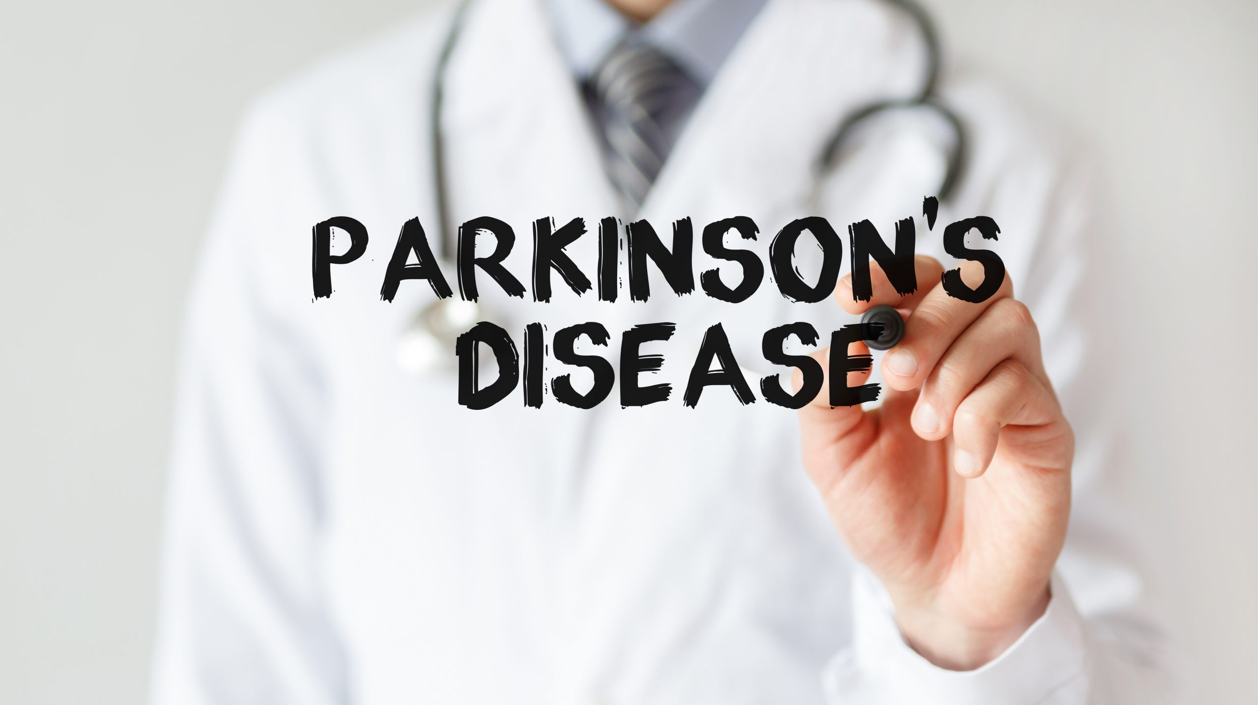 Doctor writing word Parkinson's Disease with marker, Medical concept